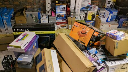 Wrexham, UK - January 24, 2019: Various appliance and product boxes stored in a home attic. Messy hoarding. 新闻类图片
