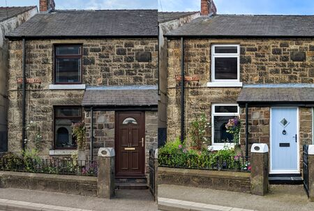 Before and after side by side images of replacement door and windows on a traditional British sandstone house.