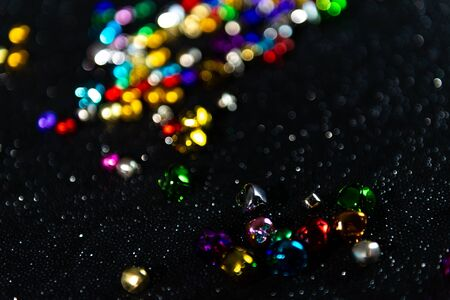 Colourful bells. Black blurred bokeh glitter background. Shallow depth of field. For overlay, background or texture. Tilted. Stock Photo - 131489925