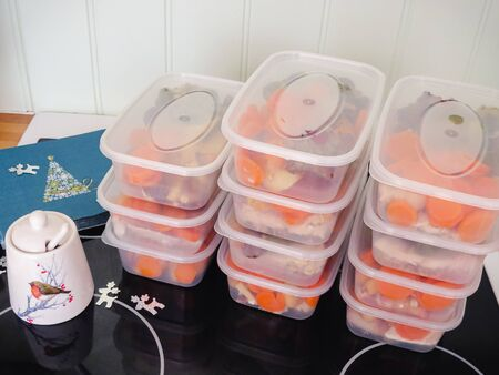 Meal prep. Stack of home made Christmas dinners in containers ready to be frozen for later use. High Angle view. 免版税图像