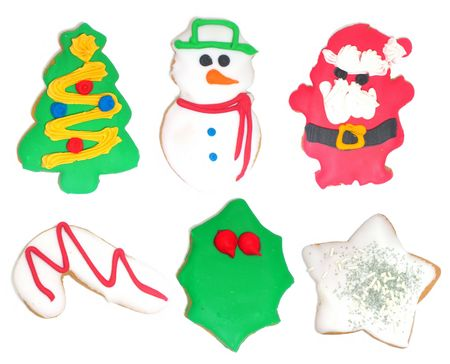 white background with cookies shaped and painted for Christmas and New Years celebration (each one is smaller here than it is on individual phots) photo