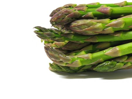 asparagus stems on white background photo