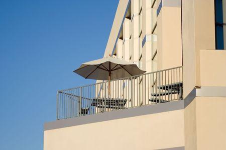 a balcony with umbrella