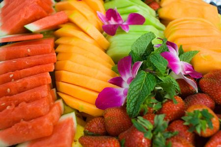 fruit salad: picture of fruit salad with different fruits and flowers Stock Photo