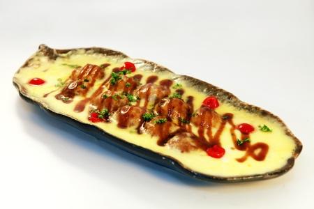 japenese: Mariscos sazonados con salsa de soja en la placa de