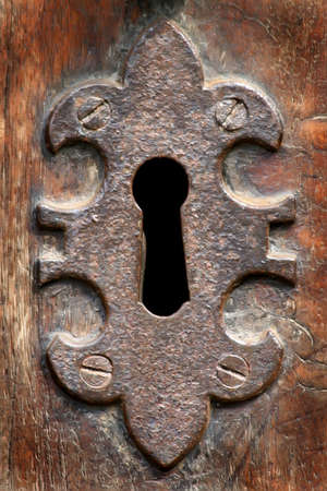 Old fashioned key hole on a door photo