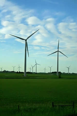 converts: A wind turbine is a rotating machine which converts the kinetic energy in wind into mechanical energy. If the mechanical energy is used directly by machinery, such as a pump or grinding stones, the machine is usually called a windmill. If the mechanical e