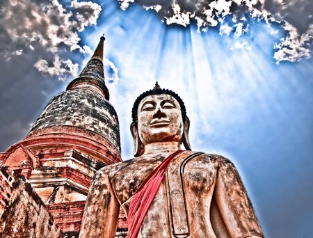 The Buddha status with light from heaven photo