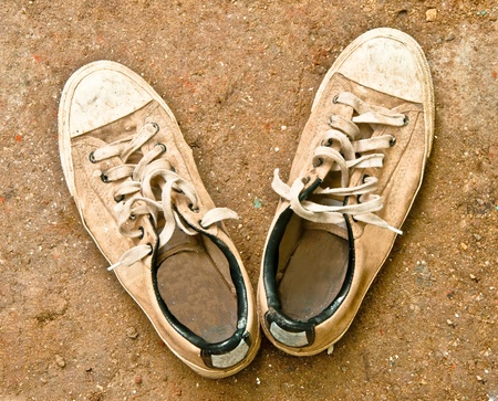 The Old sneakers on floor background photo