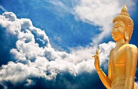 The Buddha status on cloud background photo