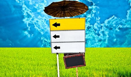 The Guide post on green field and blue sky background Stock Photo - 9120009