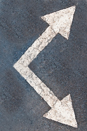 The White arrow on the road background photo