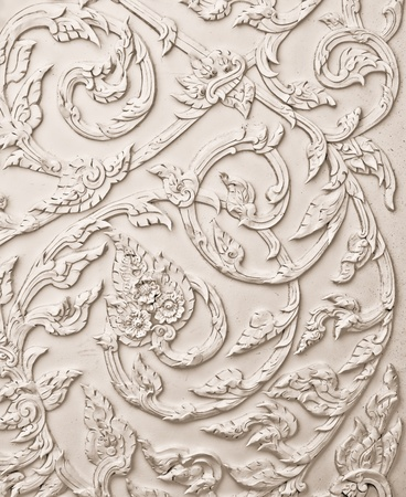The White stucco design of native thai style on the Wall Stock Photo - 10986767