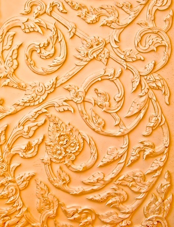 The Brown stucco design of native thai style on the Wall Stock Photo - 10924229