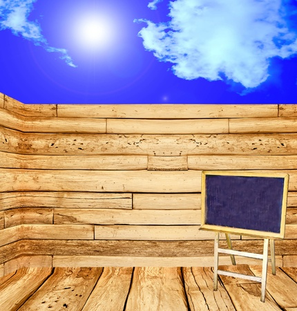 The Blackboard  on wood wall and blue sky background photo