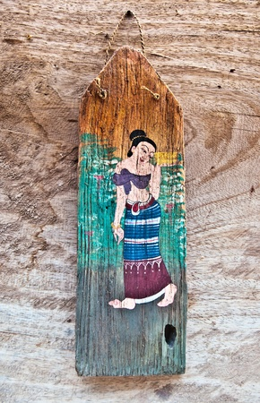 The Old painting on wood isolated on wood background