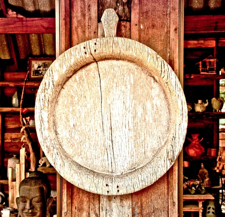 The Old wooden circle frame on wood pole background