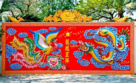 The Colorful of dragon and phoenix on wall of joss house