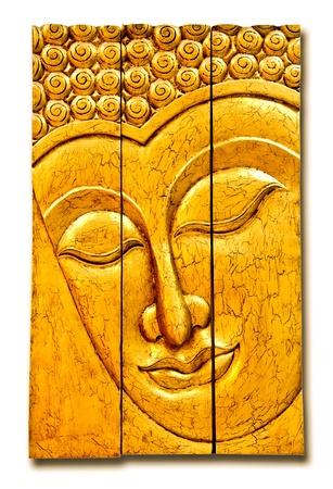 The Carving wood of buddha status isolated on white background photo