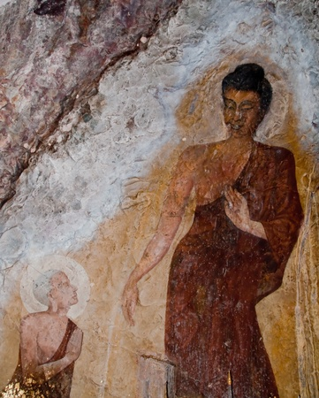 workship: The Old painting of buddha status in cave Editorial