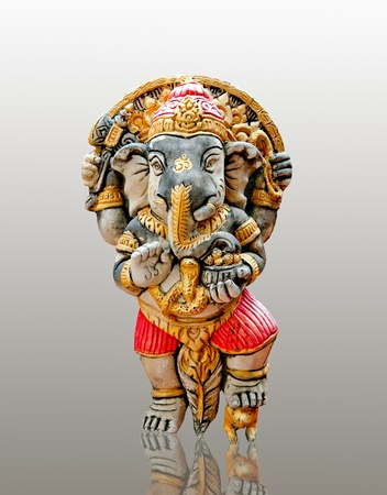 The Carving rock of  ganesha isolated on reflect background photo