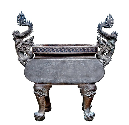 The Old steel dragon Incense burner isolated on white background photo