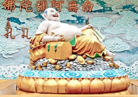 status: The Smile buddha status of joss house