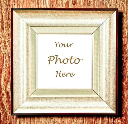 The Vintage blank wooden frame  isolated on wood background photo