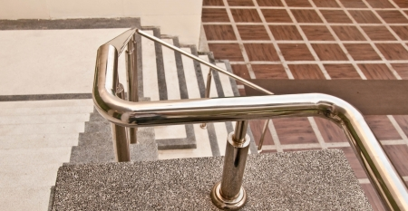 The Stainless steel of railing on staircase
