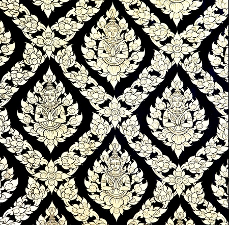 The Traditional Thai style art golden painting pattern on the wall in temple Stock Photo - 11953216