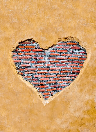 The Heart shape on brickwall background Stock Photo