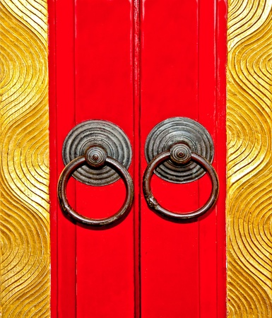 The Rusted knocker of red door chinese style photo