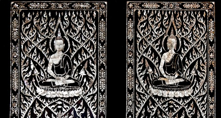 The Thai art of buddha status carved pearl shell on old wood photo