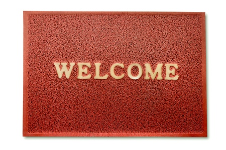 The Doormat of welcome text isolated on white  background photo