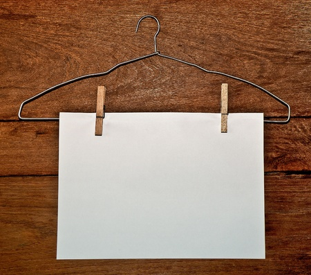 paper hanger: The White paper and hanger on wood background