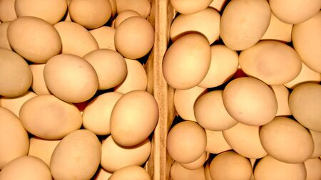 The Fresh eggs on wood container photo