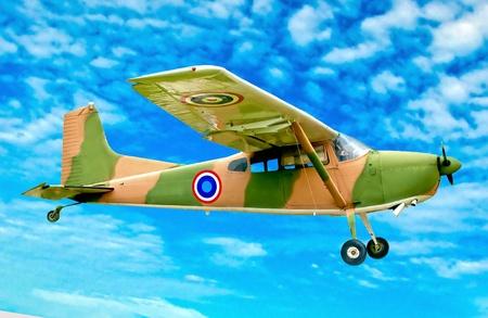 The Vintage plane of worlld war on blue sky background photo
