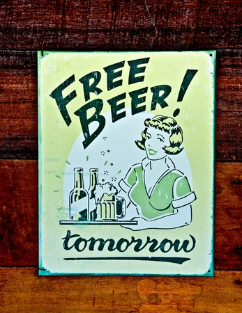The Old poster of beer on wood background photo