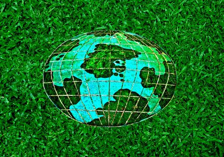 The Ceramic of whole world on green grass background photo
