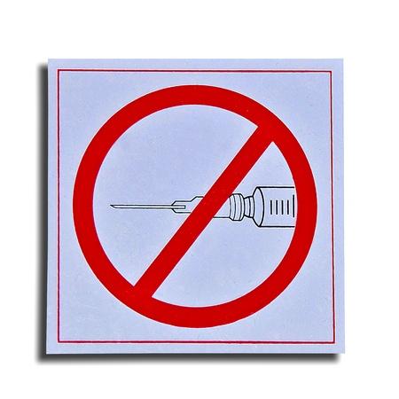 The Symbol of do not leave syringe with needle isolated on white background photo
