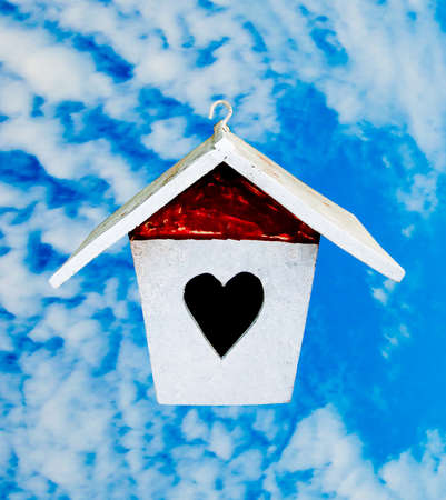 The Wooden of birdhouse on blue sky background photo