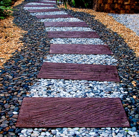 The Stone block walk path with pebble background Stock Photo