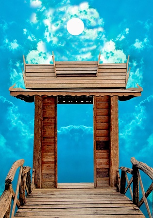 The Old Wooden door with blue sky background photo