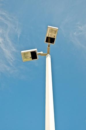 The Spotlight on blue sky background photo