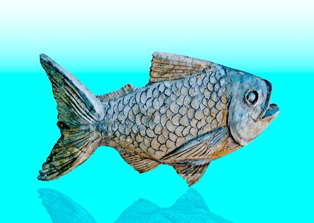The Sculpture of fish on reflect background Stock Photo - 12309630
