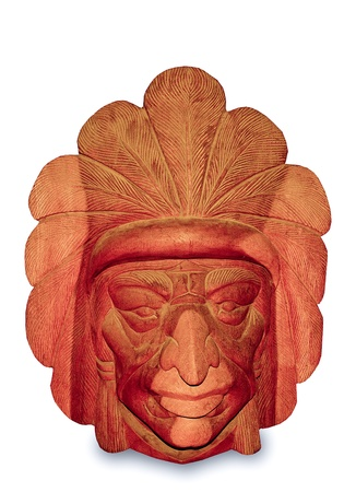 The Carving wood mask of Native indian isolated on white background photo