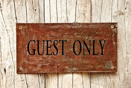 The Drilled text of guest only on iron sheet background photo
