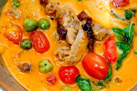The Closeup of red curry with  roast duck thai style photo