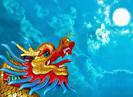 The Dragon status isolated on blue sky background photo