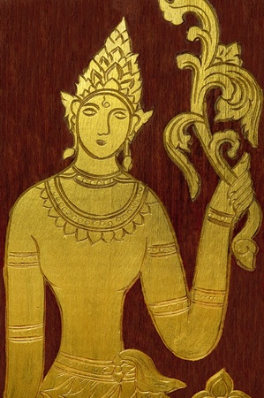 The Carving golden pattern deva on wood Stock Photo - 12617200